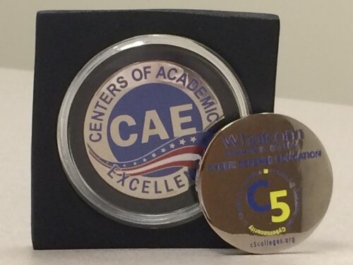 C5 presented successful CAE and CAE2Y mentee institutions with a commemorative challenge coin